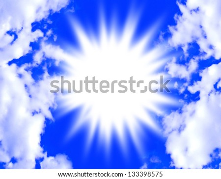 A brilliant burst of light in a bright blue sky framed by fluffy white clouds. - stock photo