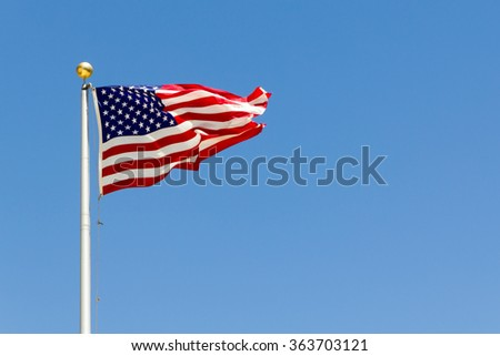 a brisk breeze blowing the US flag - stock photo