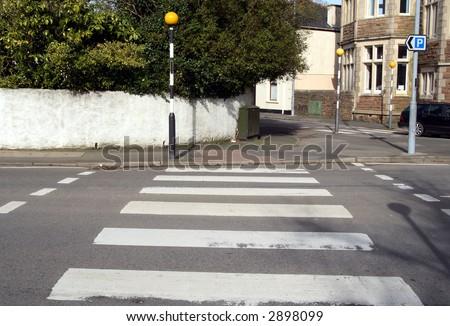 A British pedestrian zebra crossing. - stock photo