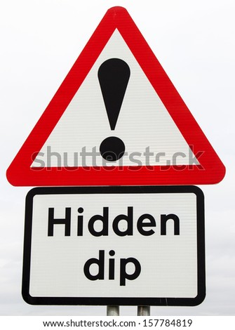 A British road sign warning of a hidden dip in the road ahead; a possible metaphor for life