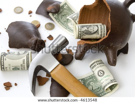 a broken and empty clay piggy money box with money and hammer over white background - stock photo
