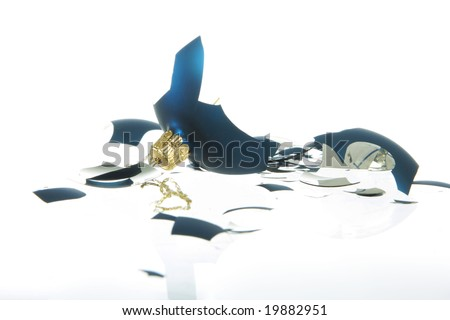 A broken blue christmas ball, isolated on white shot in studio - stock photo