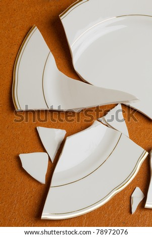 A broken dish is on the floor in the kitchen - stock photo