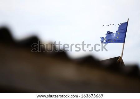 A broken flag of the European Union - stock photo