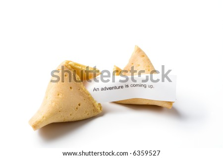 "a broken fortune cookie isolated on white with message ""an adventure is coming up"""