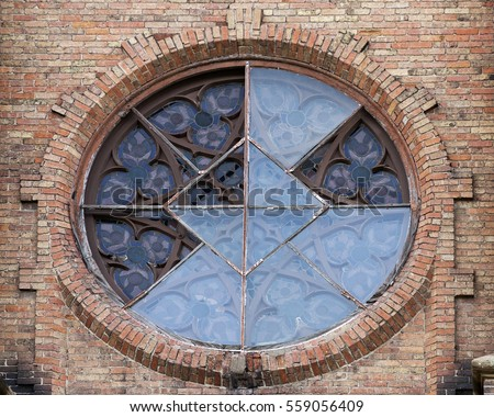 a broken round window from an old church