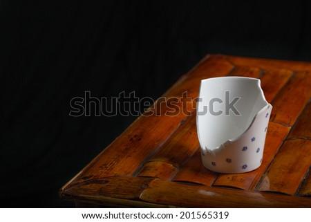 A broken tea cup - stock photo