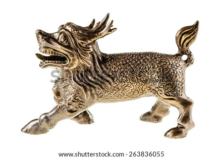 a bronze chinese dog or dragon isolated over a white background - stock photo