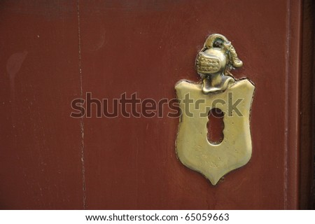 a bronze detail of the old medieval door - stock photo