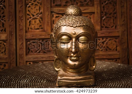 A bronze figurine of the Buddha at the room interior. They are not subject to copyright
