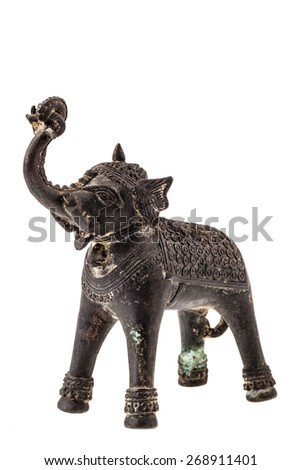 a bronze indian elephant figurine isolated over a white background - stock photo
