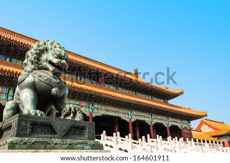 A bronze lion stands guard at the Forbidden City in Beijing, China. - stock photo