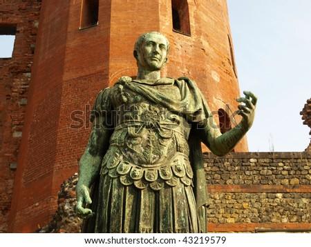 A bronze roman statue in Turin, Italy - stock photo