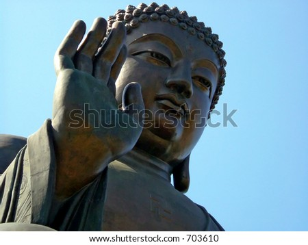 A bronze statue of Lord Buddha. - stock photo