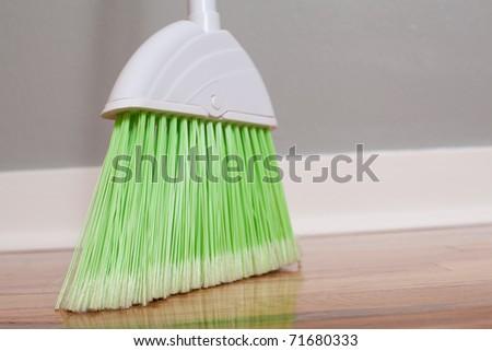 a broom on new hardwood floors