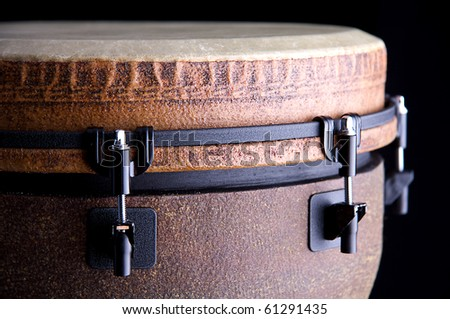 A brown African or Latin Djembe conga drum isolated on black background. - stock photo