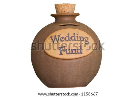 """A brown and tan piggy bank with the words """"wedding fund"""" stamped on the front. Designed for people that are saving up some change for a wedding on a white background complete with clipping path. - stock photo"""