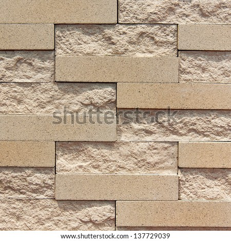 A brown brick wall (repeat background) - stock photo