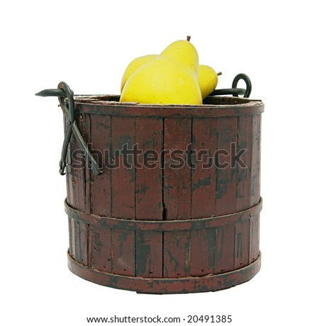a brown bucket of yellow apples over a white background