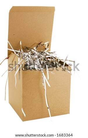 A brown cardboard gift box with lid.  Tinsel for filler - stock photo