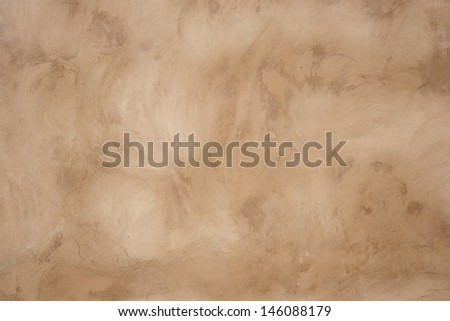 A brown cement wall suitable for texture backgrounds - stock photo