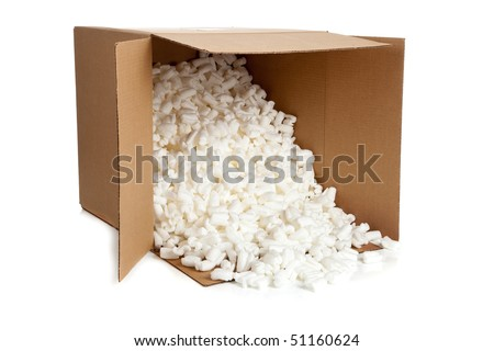 A brown, corrugated cardboard moving box with foam packing peanuts on a white background - stock photo