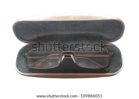 a brown glasses in a box isolated - stock photo