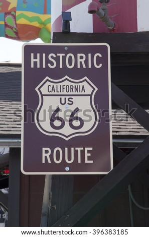 A brown histrionic route 66 sign in California