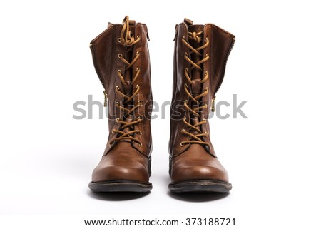 A brown leather boots(shoes) for military front side view on the bottom isolated white.