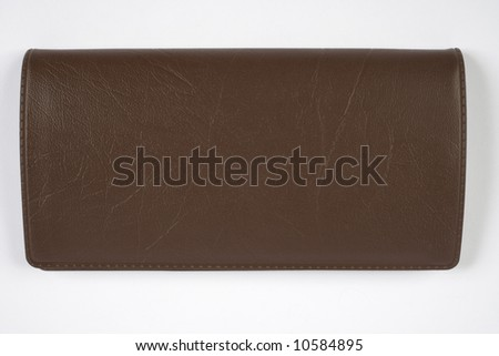 A brown leather looking checkbook closed. - stock photo
