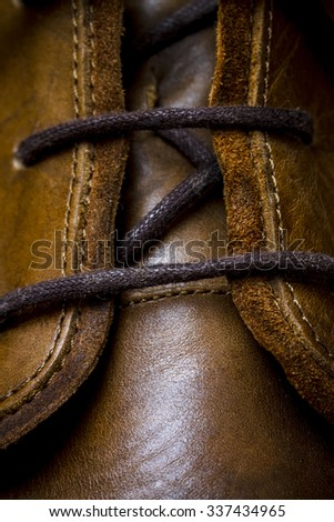 a brown leather shoes lacing macro closeup - stock photo