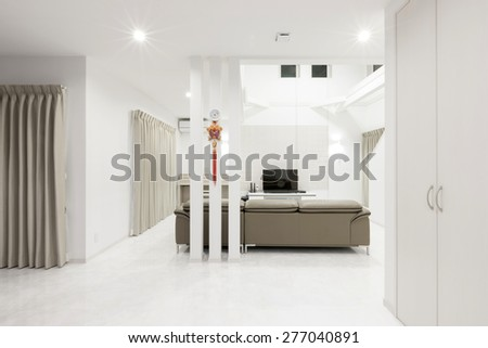 a brown leather sofa at the white living room on the marble bottom and LCD(internet) TV, piano double layered house. - stock photo