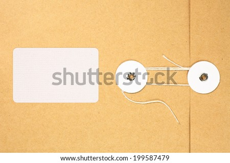 A brown paper string envelope with blank address sticker.  - stock photo