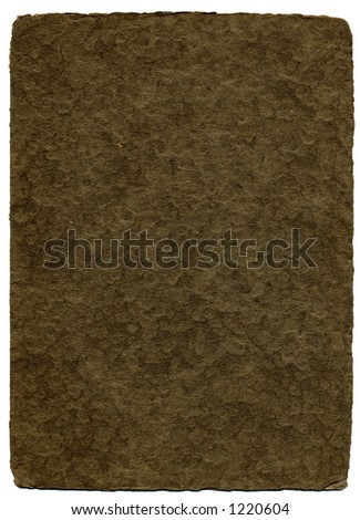 A brown textured background with wood pulp detail and an edge deckled from age. - stock photo