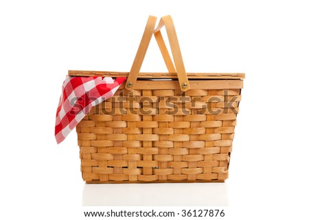 A brown wicker picnic basket on a white background with gingham cloth - stock photo