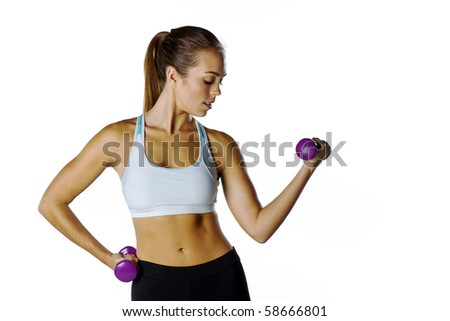 A brunette fitness model preparing to work out - stock photo