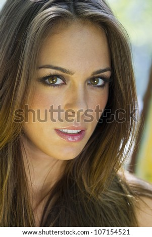 A brunette model posting in an outdoor environment - stock photo