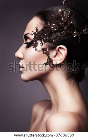 a brunette woman head profile with chocolate splash - stock photo