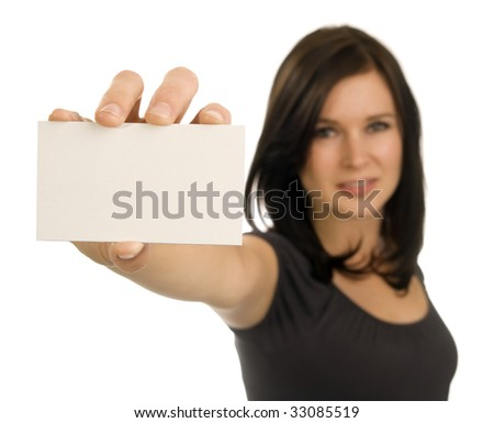 A brunette woman holds a blank, horizontal, business card at arm's length. Focus is on the card, with face out of focus.