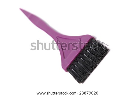 A brush used for dying hair on white background - stock photo