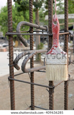 a brush with an iron rod outdoor. - stock photo