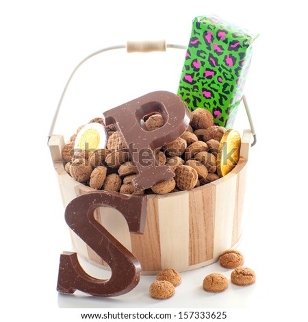 "A bucket full of pepernoten, for celebrating a dutch holiday "" Sinterklaas ""  on the fifth of December - stock photo"