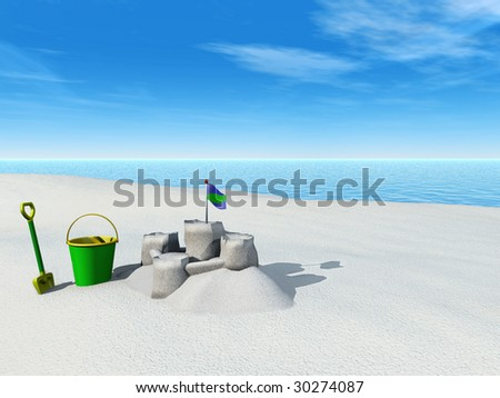 A bucket, spade and sand castle on a beach by the sea on a sunny summer day. - stock photo
