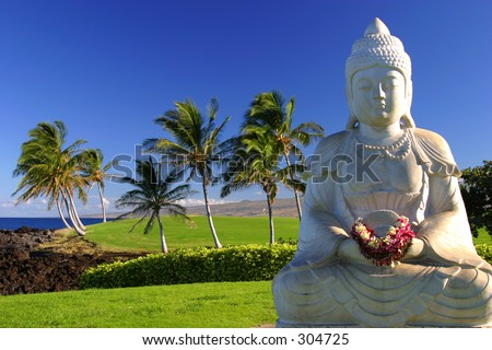 A Buddha in tropical paradise by the ocean on the Big Island of Hawaii. - stock photo