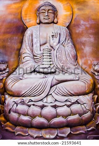 A Buddha sitting on lotus and holding a pagoda - stock photo