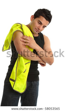 A builder, construction worker, tradesman employee holding an injured hurt, sprained or aching arm. - stock photo