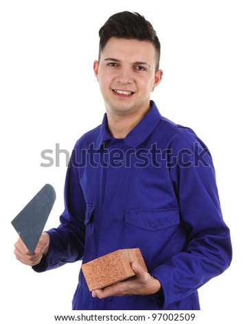 A builder with tools and a brick, isolated on white - stock photo