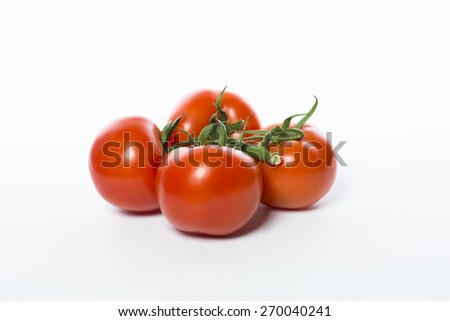A bunch of a fresh, red and juicy tomatoes isolated - stock photo