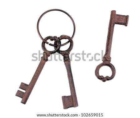 a bunch of antique keys and one single key isolated on white