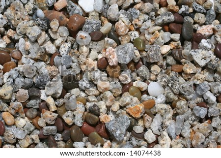 A bunch of beach pebbles to be used as a background - stock photo